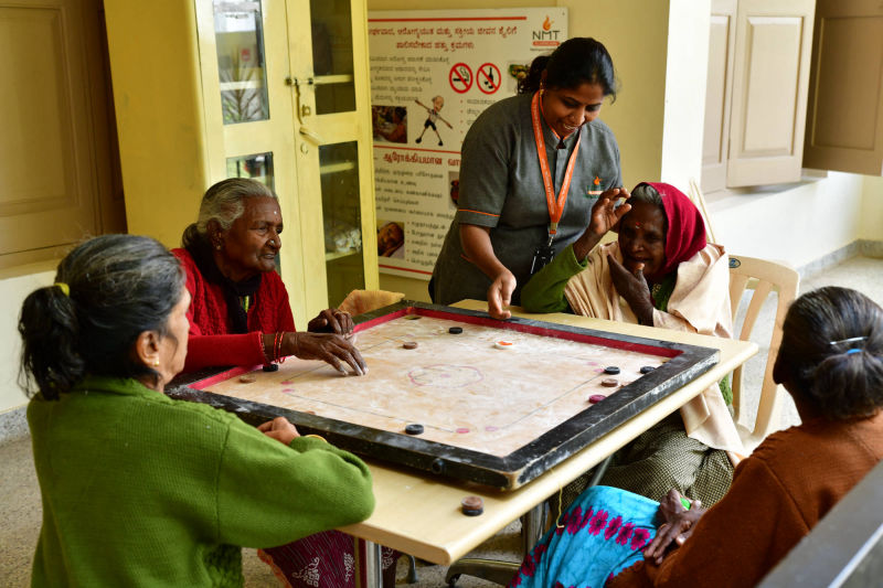 Residents playing Carrom